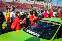 Fans checking out the car