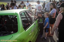 Fans enjoying this awesome green car